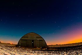 a hangar in a field